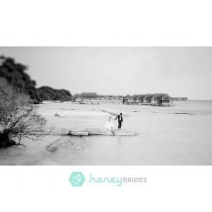 Maldives Pre-Wedding & Destination Weddings by Film Photographer Brian Ho. Featured at Honey Brides. Four Seasons Maldives at Landaa Giraavaru